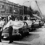 By midafternoon, with 12th Street on fire from stem to stern and undermanned Detroit police rapidly becoming overwhelmed, Governor George Romney decided to call in the National Guard.