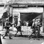 With 12th Street as the riots epicenter, the riot quickly spread in every direction. Here Guardsmen begin the sweep of neighboring Linwood Avenue.
