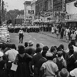 Many of the younger mourners had become overwhelmed with grief and incensed with rage over the killing of Evers. Here Jackson police, with guns drawn and clubs in hand, block their route, refusing to allow the march to continue.