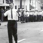 Justice department lawyer John Doar sensed a riot was at hand and jumped in just in time to persuade the anguished crowd, in the name of Medgar Evers, to turn back which they did.